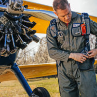 man looks down at Butler back parachute harness